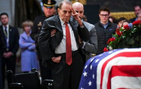 May he rest in peace: Former Senator Bob Dole gave his last salute to the late President Bush. The funeral for President Bush was on Dec. 6.