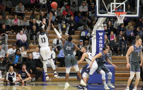 FADE:Senior guard Tyas Martin fades away on this jump shot against Rockhurst. Washburn erased a second half deficit to defeat the Hawks by four.