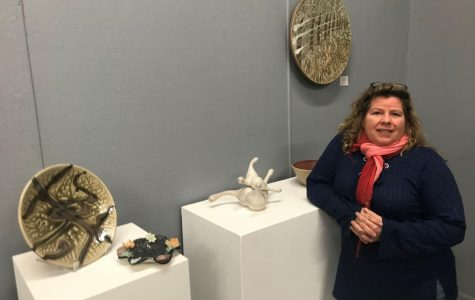 Hard work paid off:Monette Mark showcases art at Fire Me Up Ceramics and Fine Arts Studios. The studio will have its official ribbon cutting ceremony at 6 p.m. Friday, February 2.
