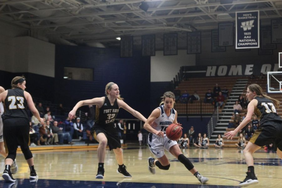 Driving+to+the+hoop%3A+Junior+guard%2C+Alexis+McAfee%2C+drives+to+the+hoop+against+Fort+Hays+State+on+Saturday.+The+Ichabods+lost+59-51.