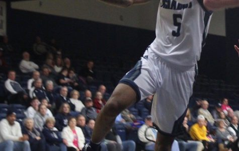 Drawing contact: Senior guard Javion Blake drives to the basket in an attempt to score. Blake is in the top 5 of all-time scorers in Washburn history.