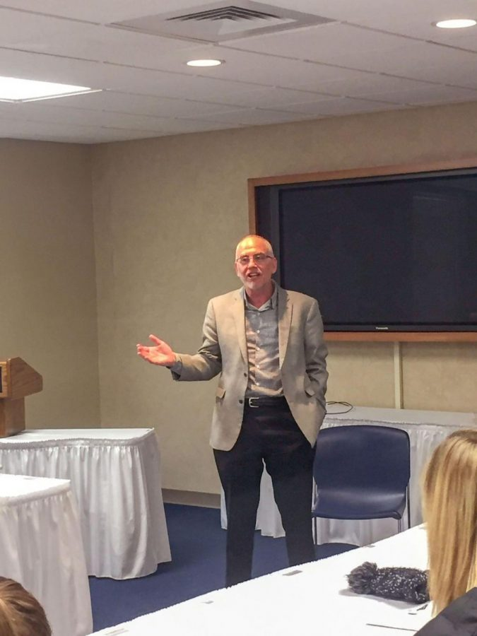 Treasure of a planet:Mark Ruelle, former CEO of Westar Energy, speaks to Washburn students and faculty at a lunch held by Beta Alpha Psi. Ruelle spoke about the future of sustainable energy and what it looks like to be a leader in any field of work.