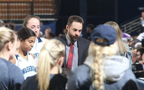 Leader:Todd Stutzman listens in on a timeout and helps coach his team. Stutzman spent time in Tennessee and Texas and is happy to be coaching closer to home.