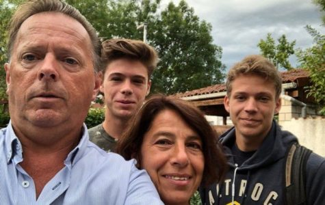 Tennis titan: Brad Eidenmueller stands with his parents and younger brother. Eidenmuller's mother was a huge influence on jump starting his career in tennis.