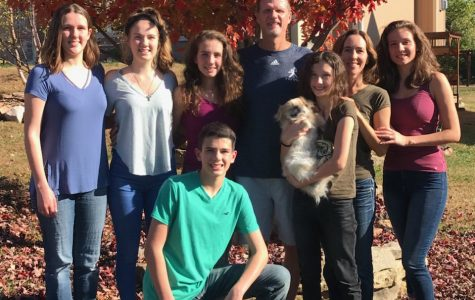 In it to win it: Madison Lysaught (back row, third from left) stands with her five siblings and her parents, Alisa and Lance Lysaught. Madison Lysaught is nearly finished with her third year at Washburn.
