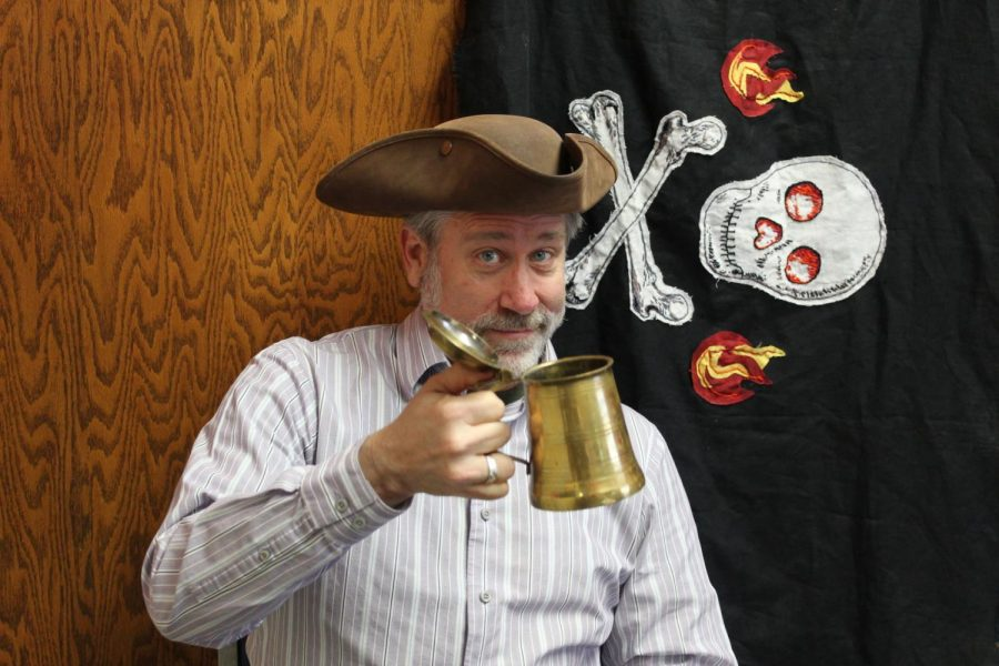 Cheers to you: Silvestri raises a tankard that he has in his office. The lecturer has had an interest in pirates ever since he was a kid.