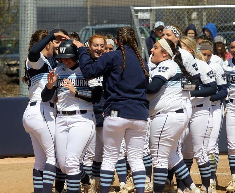 We+are+a+team%3A+The+softball+team+surrounds+home+plate+to+celebrate+senior+Savannah+Moore+after+she+hit+a+home+run.+Moore+was+an+all-MIAA+third+baseman.