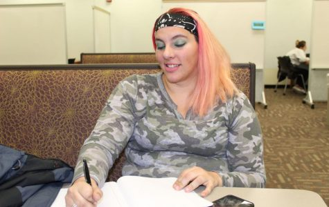 Mom-umental movement: Larissa Morgan works on homework during her free time. Morgan started Students with Children last fall for nontraditional students like her.