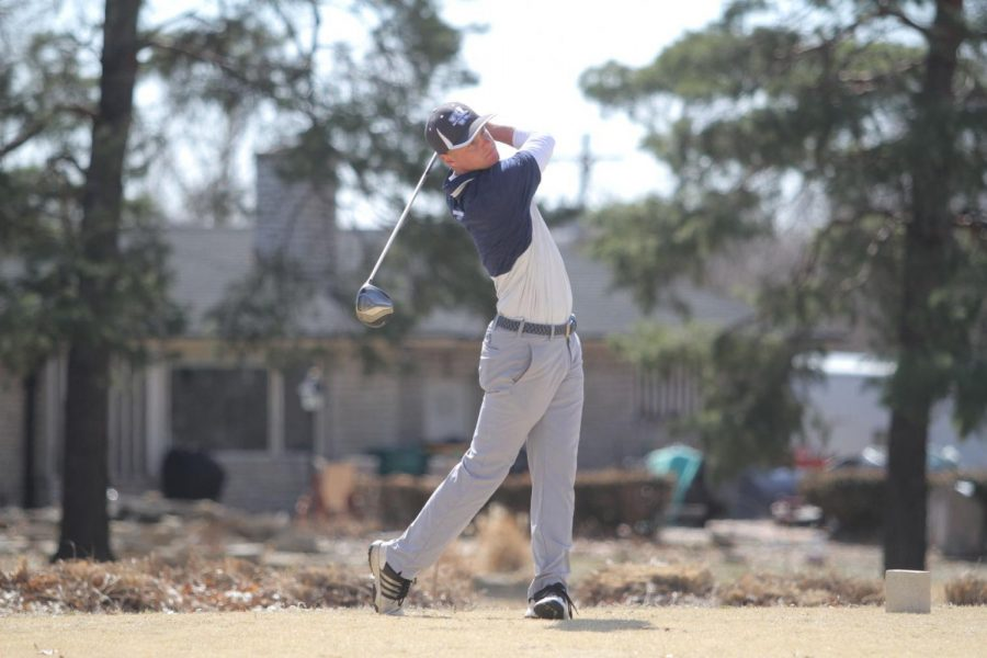 Watch it fly: Junior Blake Allen follows through a swing and watches the flight of the ball. Allen has started the spring season strong winning the Washburn Invitational.