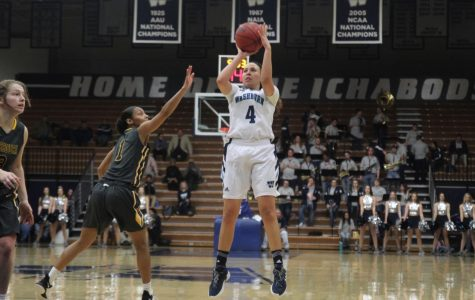 Dropping dimes: Senior forward, Taylor Blue spots up a jump shot against Missouri Western State on Saturday. Blue led the team with 25 points.