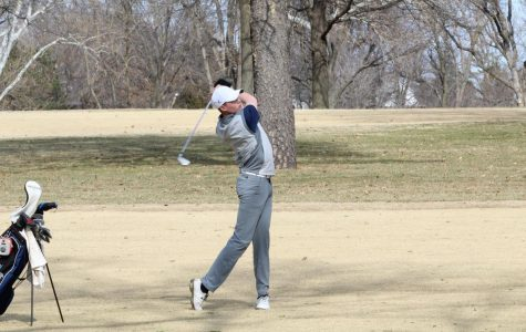 Follow through: Freshman Chase Dillion takes a shot from the fairway looking to hit the green. Dillion competed as an individual during the Washburn Invite.