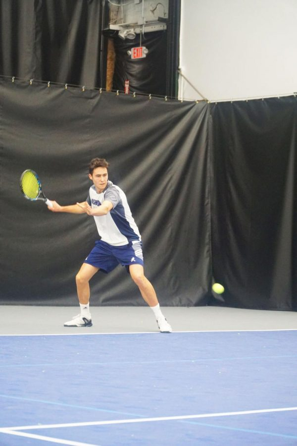 Sweeping+success%3A+Marc+Roura+Casi+sets+up+to+smack+a+forehand+during+his+singles+match+against+Newman+University.%C2%A0