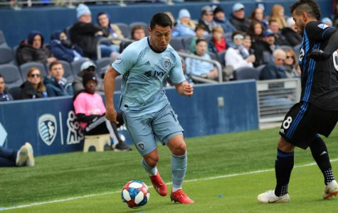 Tap n go: Midfielder, Roger Espinoza moves the ball down the sideline past the defenders to set his teammates up with a shot. Sporting KC went on to defeat Montreal Impact 7-1.