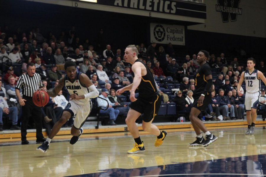 Driving to the rim: Senior guard, Javion Blake drives to the goal against Missouri Western State. Blake dropped 32 points during Saturday's contest.