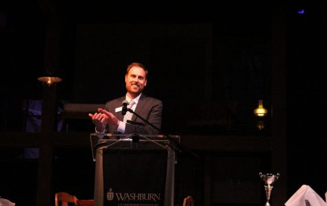 Leading leaders: Michael Gleason claps for students, faculty, staff and community members that support the Leadership Institute. Gleason made a strong impact on the Leadership Institute during his time at Washburn.