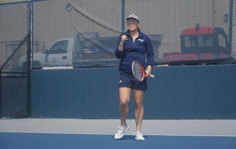 Standing Strong: Senior Alexis Czapinski celebrates winning a tough point during her singles match against Northeastern State.