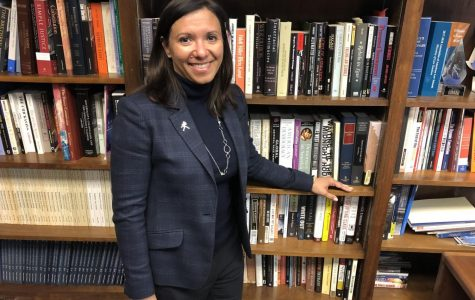 Leading the Way: Dean of the Washburn School of Law, Carla Pratt, stands in front of her bookshelf in her office. Pratt joined Washburn in the fall of 2018.