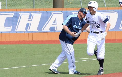 Dinger: Freshman Chance Ragsdale gets a high five and a smile from head coach Harley Douglas as he rounds third after hitting a home run. The home run was the first of Ragsdale's college career.