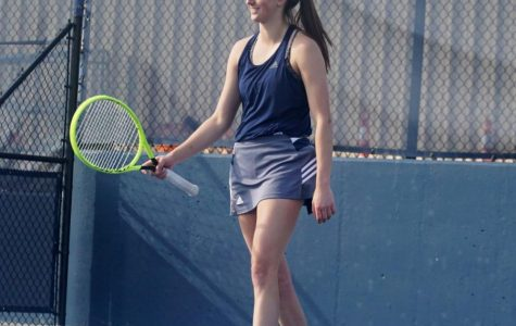 Friendly Competition: Freshman Kinsey Fields smiles during her singles match on April 2. She defeated her William Jewell opponent 6-1, 6-0.