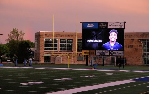 Shine on, Dwane: A rainbow shines behind Dwane Simmons as students, faculty, family and community members gathered at Yager Stadium for one last time on the field with him. A vigil for Simmons was held Tuesday, April 30 in Washburn A/B.