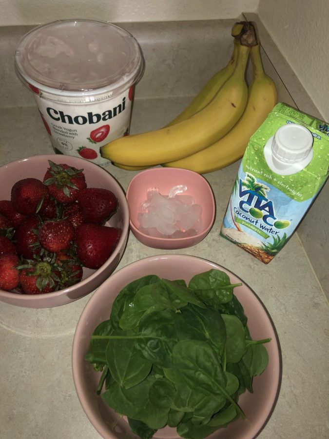 WHAT+YOU+NEED%3A%28Frozen%29+2+cups+of+Strawberries.+%28I+usually+freeze+my+fruit+before+it+starts+to+go+bad+so+that+I+can+add+them+to+smoothies+as+an+ice+substitute.%292+whole+bananasIce+%28use+as+desired%29Coconut+water2+cups+of+Greek+yogurt1+cup+and+a+half+of+fresh+spinach+leaves