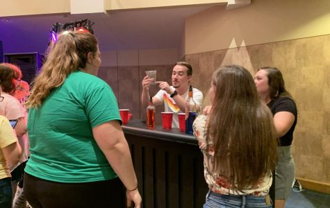 Bottoms up: The bartender teaches attendees how to pour the perfect shot. The Perfect Party was the main Wednesday welcome week event.