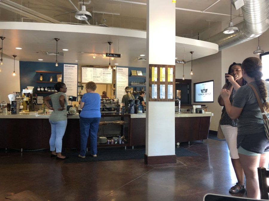 Service+with+a+smile%3A+Sara+Johnson+and+her+team+of+Baristas+work+swiftly+to+ensure+that+the+customers+receive+fresh+coffee+right+on+time+during+the+lunch+rush.+Johnson+has+worked+at+PT%27s+Coffee+for+12+years.%C2%A0
