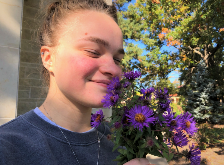 Inhale+and+exhale%3A+Sophomore+Kaylee+Schweer+stopped+to+smell+some+flowers+on+campus+in+between+classes.+Certain+scents+have+been+found+to+conjure+memories+and+alleviate+stress.