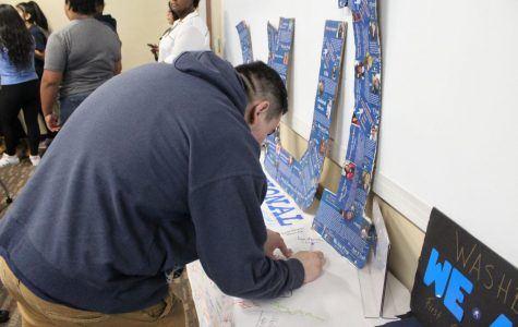 One of many: A Washburn student signs a banner expressing support for first-generation Washburn students. Many faculty, staff, and students were given the opportunity to do so thanks to We Are F1rst.