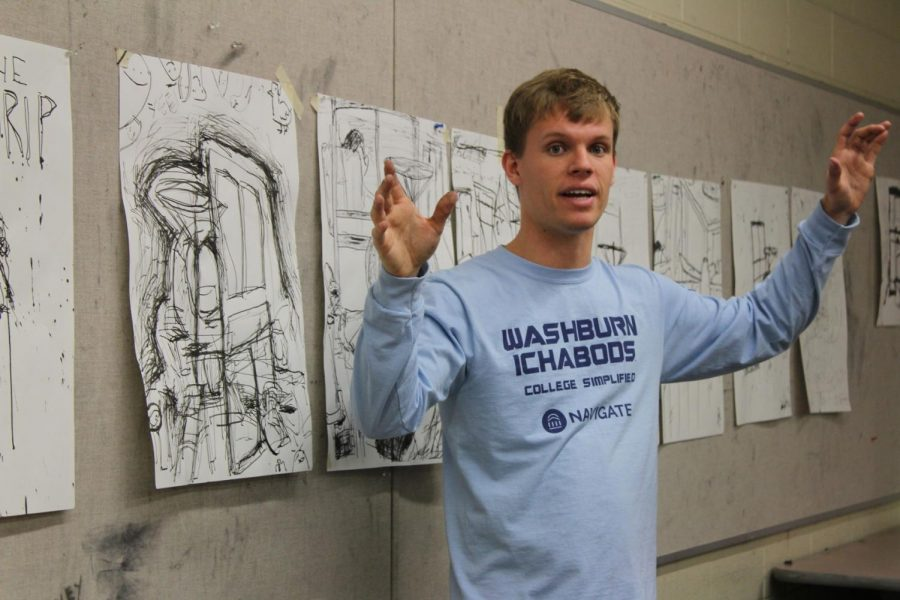Artist and scholar: Issac Bird stands in an artistic environment. Bird has been on the honor roll for most of his college career.