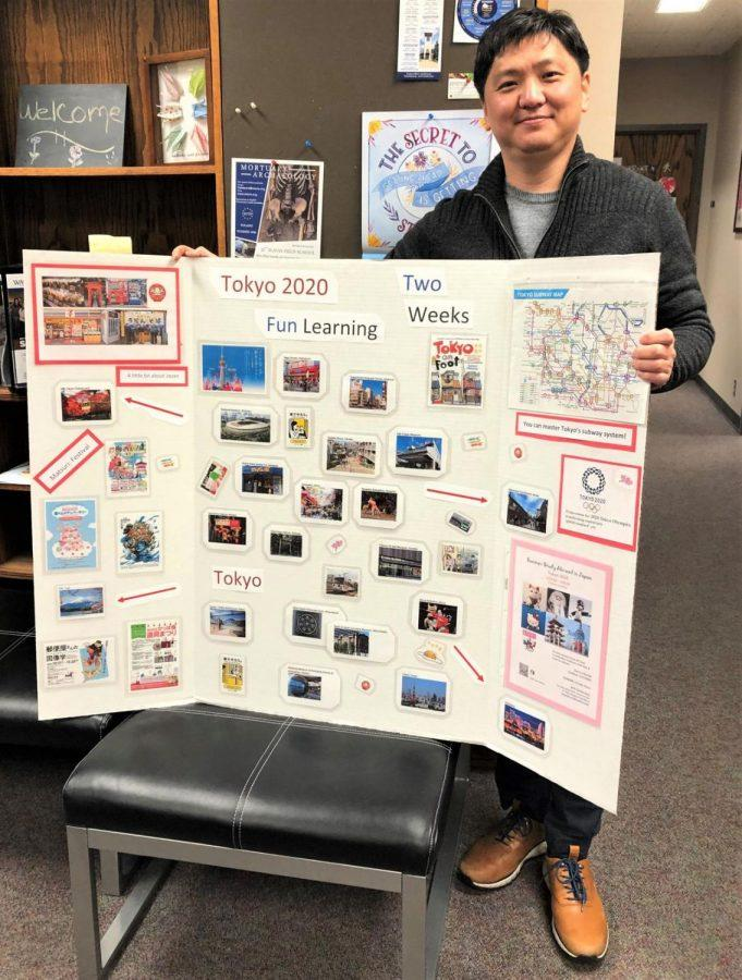 Poster perfect: Park displayed the poster he made with pictures of some of the places students could see on the Tokyo trip. Park has been to Japan before and is looking forward to bringing a group of students.
