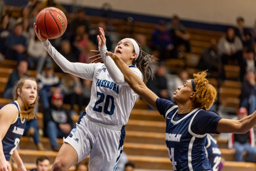 Baskets upon baskets: Senior guard Mia Castaneda is jumping up for a layup in Saturday's game against the Blue Tigers. Castaneda scored seven points and had one assist in Saturday's game against the Blue tigers.