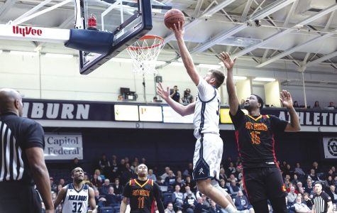 Walking on air: Jace Williamsflyingup to the basket for2 points. Williams had a total of5 points in Saturday's game against Pittsburg State.