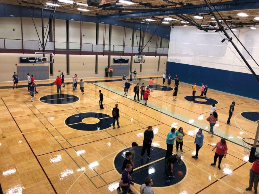 Collaboration: Washburn students collaborate with volunteers from the Special Olympics. The program has started with basketball.