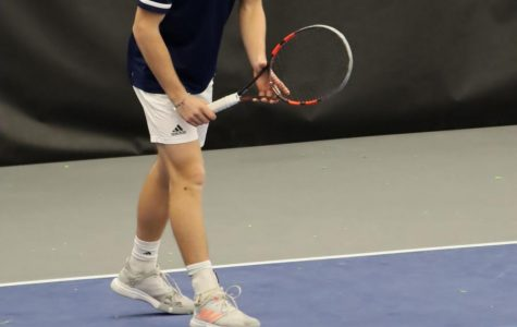 Ready for it: Chase Brill prepares for the opponent's serve. Paul Haase and Brill won their doubles match 6-1.
