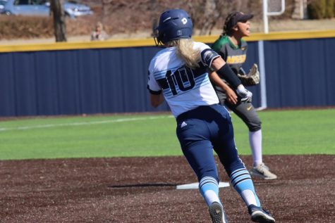 Springtime blues: Brianna Fuchs runs to the base during the Ichabods' last game of the season. Due to the MIAA cancelling the remainder of the spring season, Fuchs and other athletes will not be finishing their senior season.