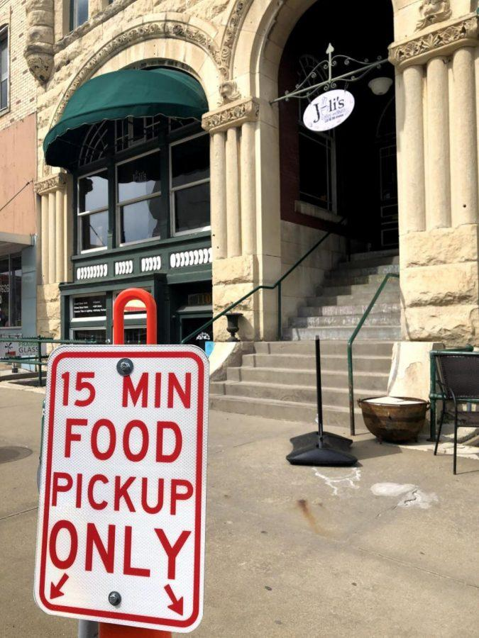 Curbside+courtesy%3A+A+sign+in+front+of+Juli%27s+Coffee+and+Bistro+in+downtown+Topeka+designates+parking+for+curbside+pickup.+This+is+one+example+of+how+the+city+of+Topeka+is+helping+local+businesses+during+this+time.
