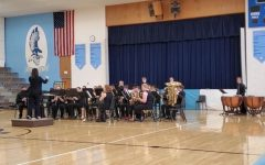 Conductor: Kristina Hernandez, senior music education major and clarinet emphasis, conducts the Rossville Senior High Band at the League Festival. Hernandez is a student teacher and has continued to instruct her students remotely.