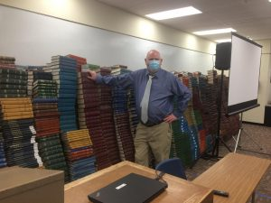 Tall as a Book: Library Dean, Dr. Bearman stands proud. The Dean explained that it was quite a chore moving all the books to the basement.