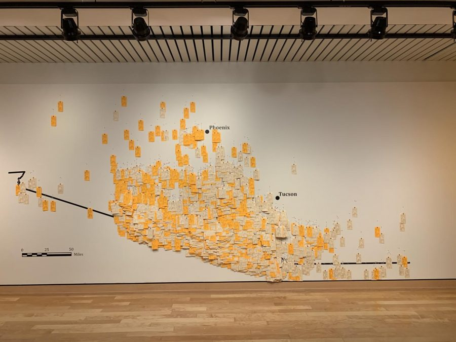 The toe tags on the wall: This is a picture of the exhibit. Toe tags on a map are displayed to show the lives that were lost on the journey.