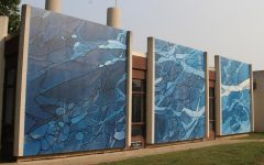 """Exploring New Worlds"" is a mural that was created by Mark Anschutz. It is located near Yager Stadium."