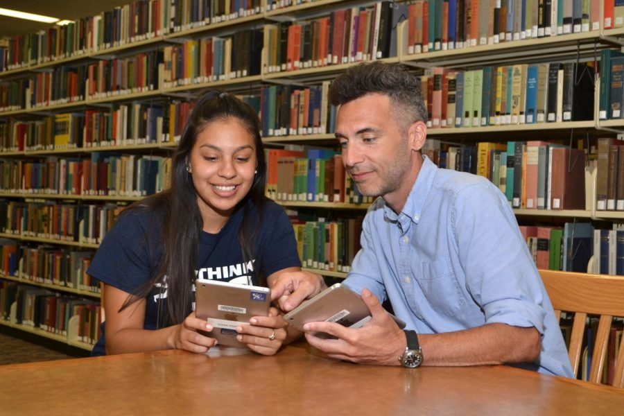 Tutoring Before Covid: A library staff member helps a student out. Through the services provided by TutorMe, students can get help without meeting someone face-to-face.