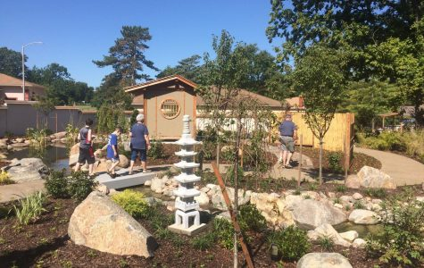 Winding Trails: The first zoo guests to enter the garden begin to make their way through the area. They gazed upon the greenery with wonder in their eyes.