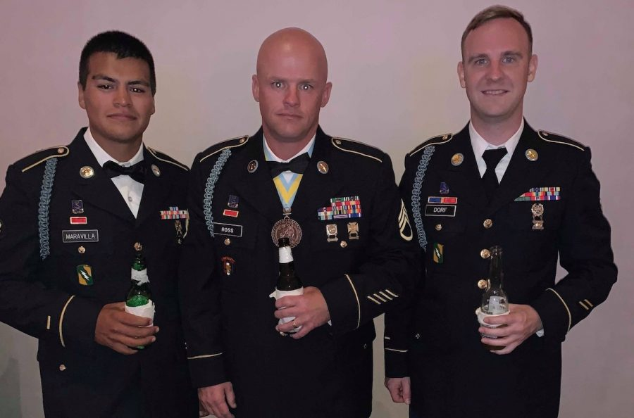 In July of 2019, this yellow ribbon is to celebrate the return of deployment and reflect on our experiences. From left: Ruben Maravilla, SSG Johnny Ross and SPC Trenton Dorf.