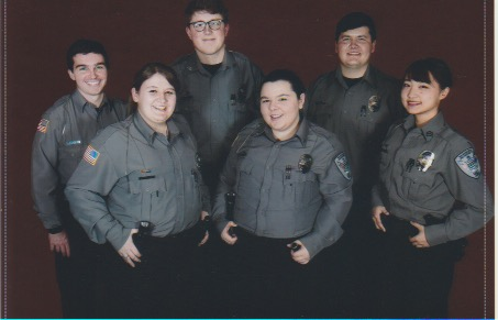 Professionals: Cadet Lt Katie Hensler standing with her fellow cadets from the program. (Left to right) Cadet Corporal Josh Wiltz, Cadet Lt Katie Hensler, Cadet Cpl Thomas Schowalter, Cadet Sgt Tori Sheets, Cadet Cpl Ellis Donaldson and Cadet Sgt Sayaka Kine.