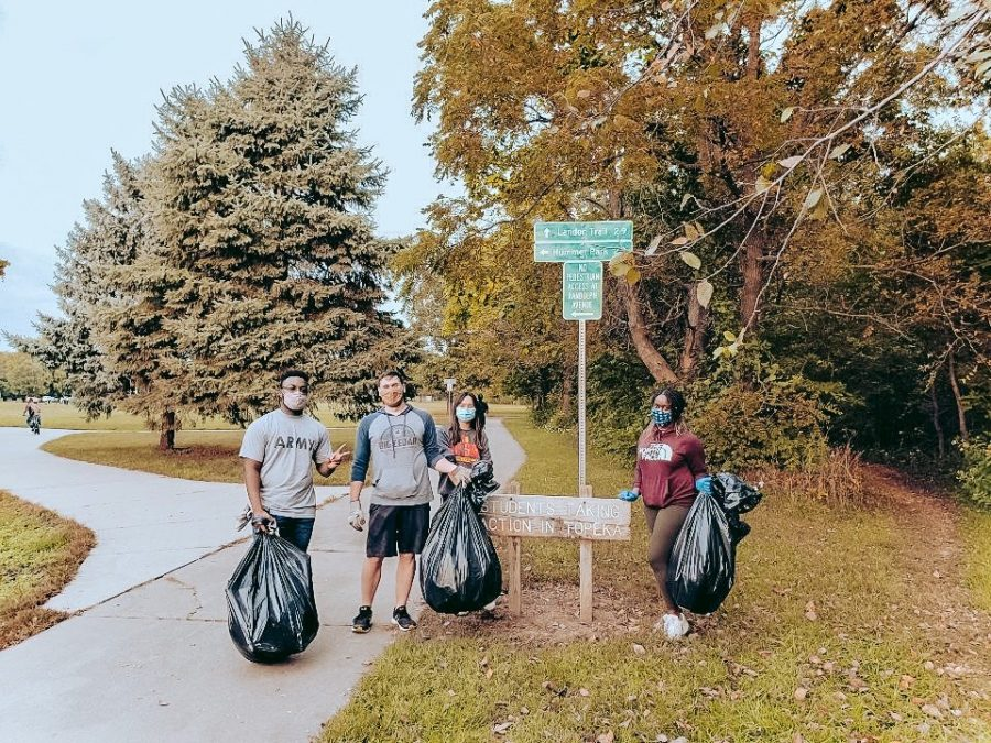 Working hard: Members of the Biology Club are seen cleaning the Shunga Trail. Their dedication resulted in a successful clean-up.