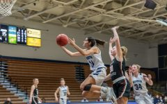 Hoop it up: Washburn's junior guard Nuria Barrientos taking it to the bucket against the Jennies defense. Barrientos had a total of 14 points in Thursday night's game.