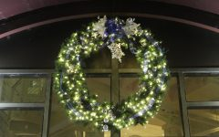 Blue and white: This large holiday wreath decorates the entrance to the dining hall. It has helped add an element of Christmas cheer to the building.