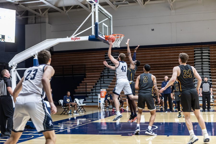 Getting fired up: Washburn's Junior forward Jonny Clausing took it to the basket against Central Oklahoma. Clausing had a total of one block and two assists during Monday's game.