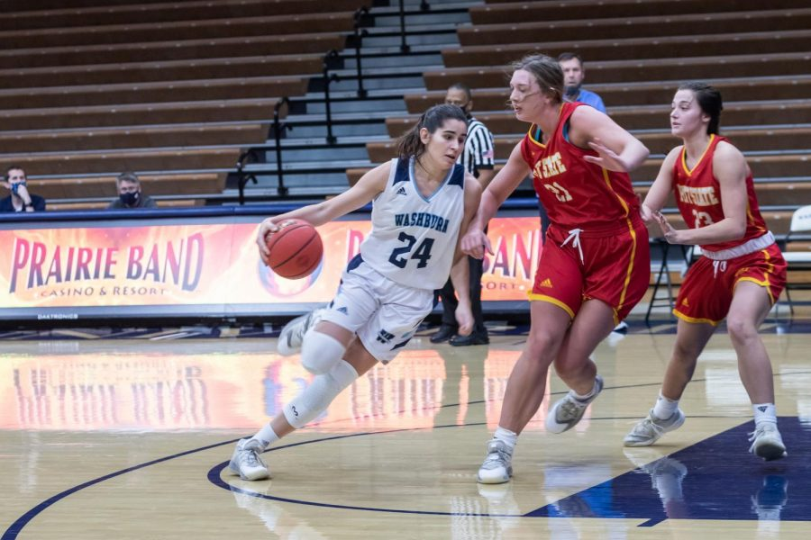 Hoop Dreams: Washburn's junior guard Nuria Barrientos driving the ball in towards the basket to make the play. Barrientos had a total of 11 points against the Pittsburg State Gorillas.